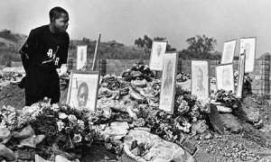 Kalusha Bwalya at the graves of Zambian national team