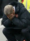 arsene-wenger-head-in-hands