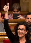 Junts Pel Si (Together for Yes) member of the Catalan Parliament Marta Rovira gives a thumbs up as she votes to pass the start of the independence process Monday in Barcelona, Spain