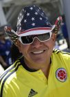 A fan wearing a Colombia soccer jersey and United States hat smiles before a Copa America Centenario Group A soccer match between the United States and Colombia at Levi's Stadium in Santa Clara, Calif., Friday, June 3, 2016. (AP Photo/Marcio Jose Sanchez)