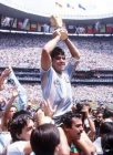 Sport. Football 1986 World Cup Final. Azteca Stadium, Mexico. 29th June, 1986. Argentina 3 v West Germany 2.  Argentina's Diego Maradona proudly holds aloft the World Cup trophy amongst masses of fans and photographers.