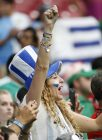 A Uruguay fan cheers on her team as they warm up prior to a Copa America group C soccer match against Mexico at University of Phoenix Stadium, Sunday, June 5, 2016, in Glendale, Ariz. (AP Photo/Ross D. Franklin)