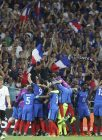 France's Antoine Griezmann, covered by his teammates, celebrates after scoring during the Euro 2016 semifinal soccer match between Germany and France, at the Velodrome stadium in Marseille, France, Thursday, July 7, 2016. (AP Photo/Petr David Josek)