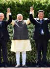 (L-R) Brazilian President Michel Temer, Russian President Vladimir Putin, Indian Prime Minister Narendra Modi, Chinese President Xi Jinping and South African President Jacob Zuma pose for a group photo during the BRICS Summit in Goa on October 16, 2016. Indian Prime Minister Narendra Modi hosted leaders of the BRICS emerging powers at a summit seeking to boost trade ties and help overcome the bloc's economic woes. / AFP PHOTO / MONEY SHARMA