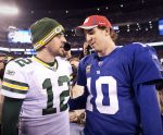 packers05, spt, lynn, 10.-Aaron Rodgers and Eli Maning talk fowlloing the game. The Green Bay Packers defeated the New York Giants 38-35 at MetLife Stadium in East Rutherford N.J. Sunday December 4, 2011.  Photo by Tom Lynn/TLYNN@JOURNALSENTINEL.COM